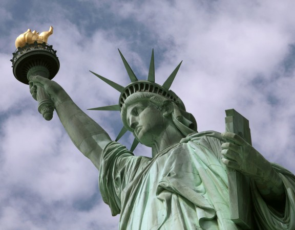 In this June 2, 2009 photo, the Statue of Liberty is seen in New York harbor. The crown is set to open July 4 after being closed since shortly after the Sept. 11, 2001, terrorist attacks. (AP Photo/Richard Drew)